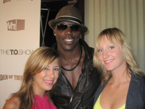 Red Carpet Roxy and friend with star of the show, Terrell Owens