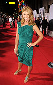 Lori Laughlin in an emerald Bottega Veneta dress and jeweled Oscar de la Renta heels photo: caulfield/wire image