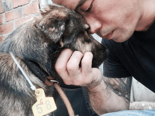 Marc Ching and one of the dogs he saved from Yulin