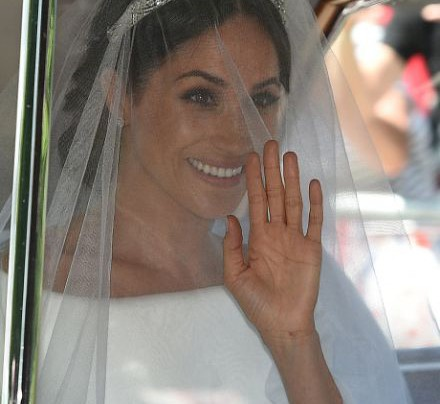 AND THE BRIDE, MEGHAN MARKLE, WORE…………