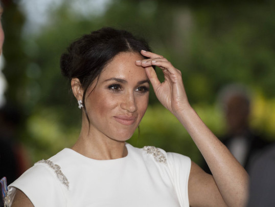 MEGHAN MARKLE SPARKLES IN IVORY