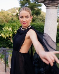 KATE HUDSON IN A SHEER CAPE DRESS IN ITALY