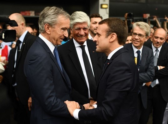 LVMH CEO Bernard Arnault and French President Emanuel Macron